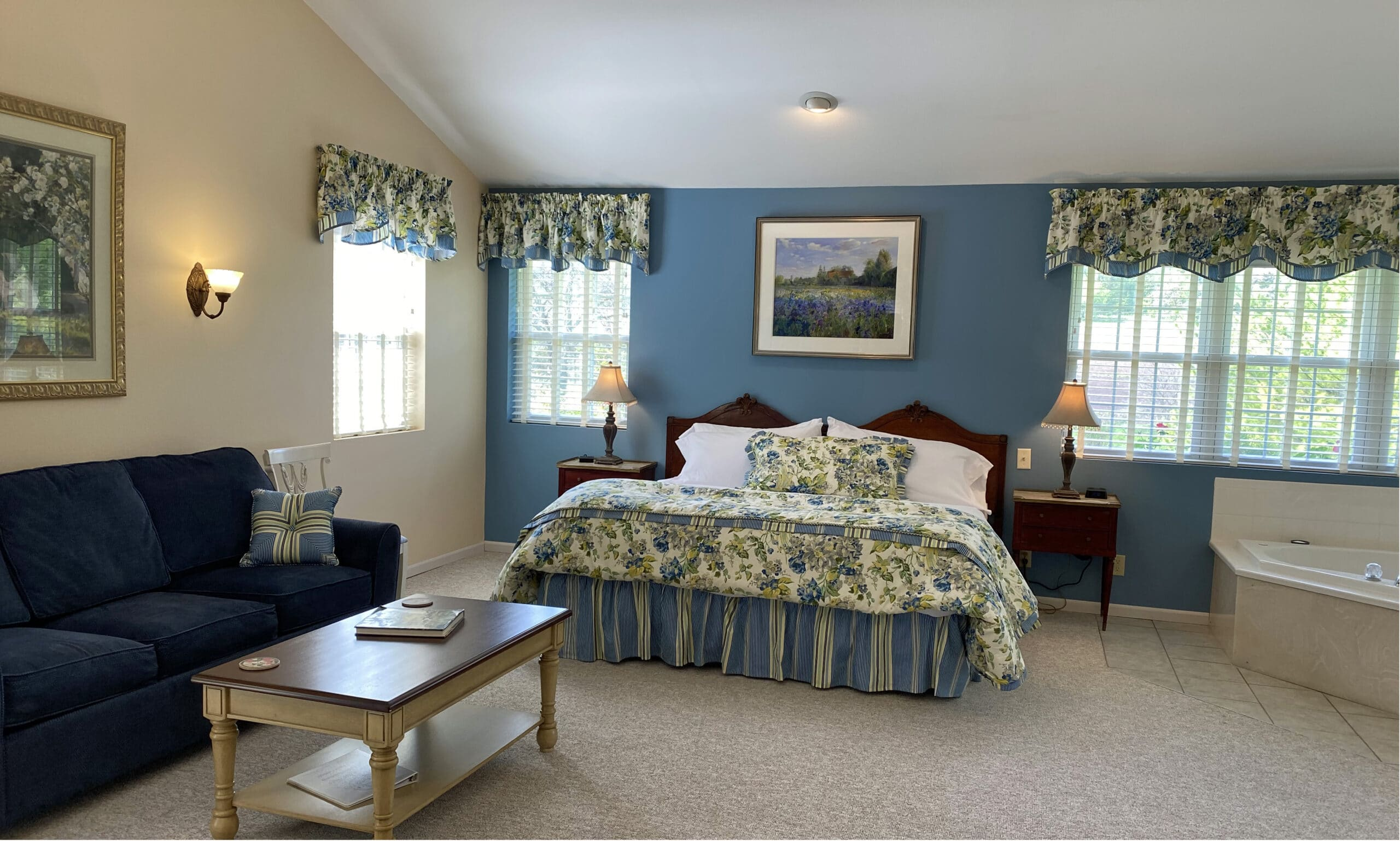 Blue Walls with large floral bed and whirlpool