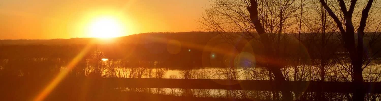 Sun rays over pond