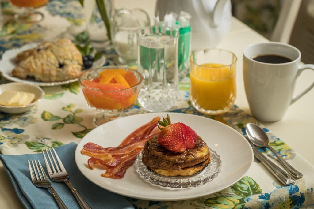 Bananas Foster French toast, fruit, scones, coffee and juice