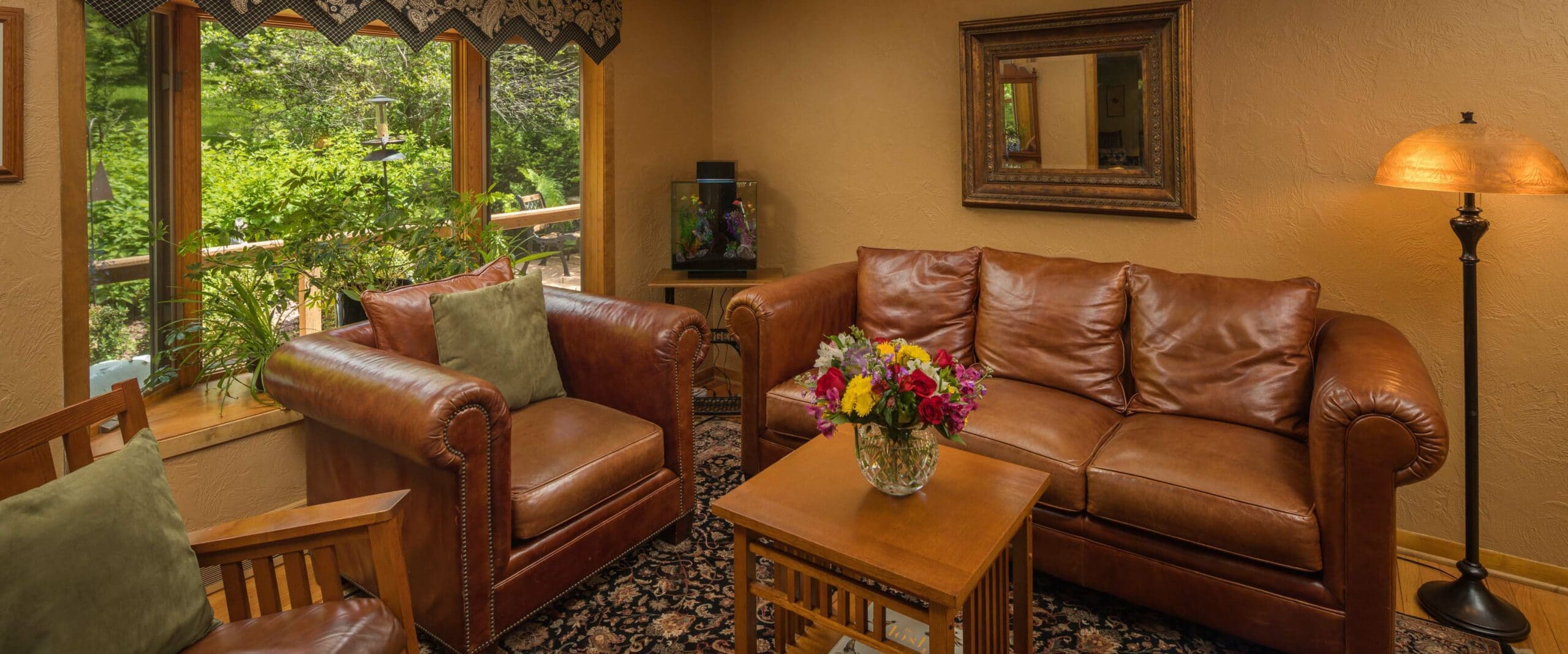 sitting room with leather couches and coffee table