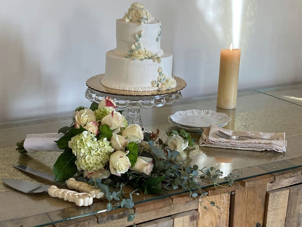 bouquet and cake on counter